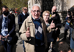 © Licensed to London News Pictures. 23/04/2021. London, UK. Former Post Office sub-postmaster Noel Thomas gives a thumbs up as he talks to reporters outside The High Court. The Appeal Court has cleared the names of a group of 42 sub-postmasters - some of whom were jailed for stealing money after the Horizon accounting software was installed at Post Offices. At a previous High Court hearing a judge found the Fujitsu accounting system had major faults and defects. The Post Office has already agreed to pay £58m in a settlement with more than 500 sub-postmasters. <br /> Six convictions were overturned last year . Photo credit: Peter Macdiarmid/LNP