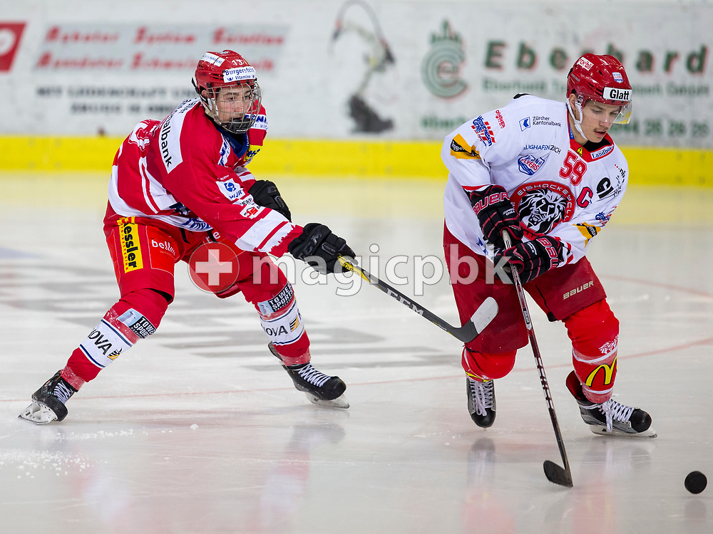 Rapperswil-Jona Lakers forward Jonas Graetzer (L) and EHC Winterthur defenseman Joel Sigg vie for the puck during the first Elite B 1/2 final Playoff ice hockey game between Rapperswil-Jona Lakers and EHC Winterthur in Rapperswil, Switzerland, Sunday, Feb. 25, 2018. (Photo by Patrick B. Kraemer / MAGICPBK)