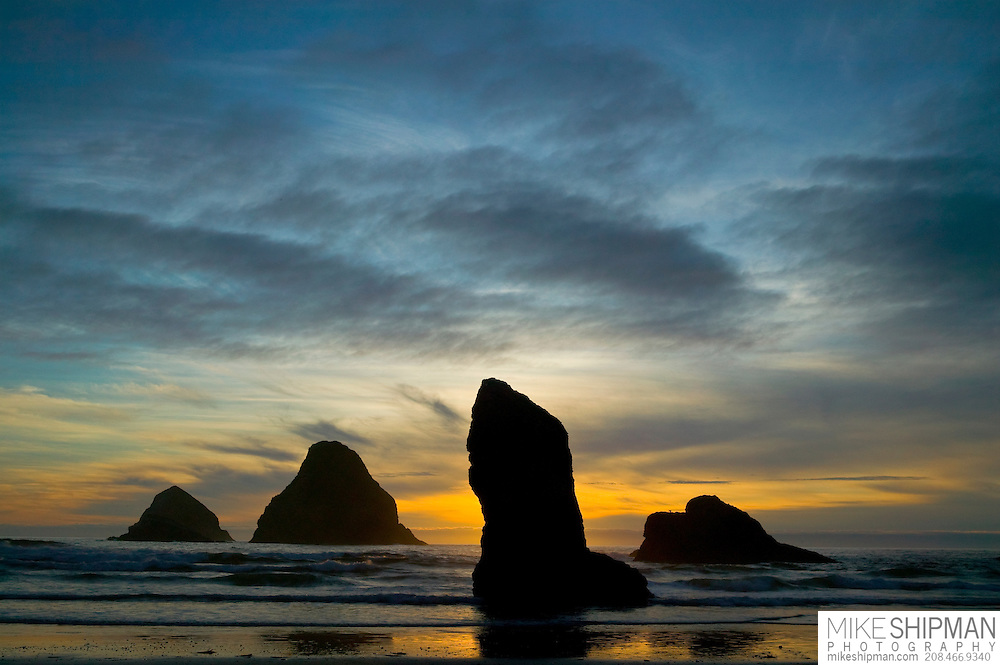 Orange sunset at Three Arch Rocks with sea stacks, Oceanside, Oregon, USA