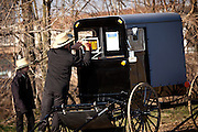 Amish family inspects a horse buggy during the Annual Mud Sale to support the Fire Department  in Gordonville, PA.