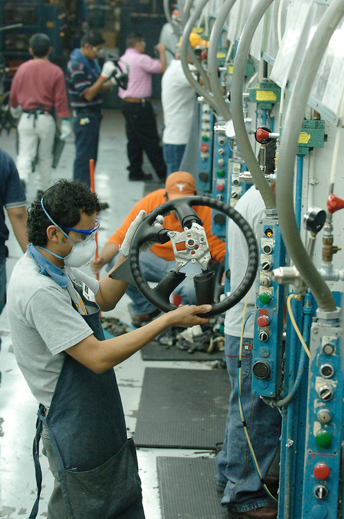 Matamoros, Mexico April, 2006: Steering wheel manufacturing at Delphi Delco Electronics de Mexico, a maquiladora plant across the U.S. border that makes parts for General Motors cars. Delphi has about 11,000 Mexican workers in seven factories near Matamoros.  ©Bob Daemmrich /