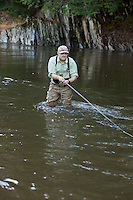 Angler and guide, Drew Price casting for trout on the Dog River in central Vermont