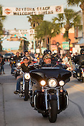 Bikers ride down Main Street during the 74th Annual Daytona Bike Week March 8, 2015 in Daytona Beach, Florida. More than 500,000 bikers and spectators gather for the week long event, the largest motorcycle rally in America.