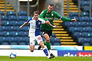 Blackburn Rovers midfielder Jacob Davenport (18) and Birmingham City midfielder Gary Gardner (20) during the EFL Sky Bet Championship match between Blackburn Rovers and Birmingham City at Ewood Park, Blackburn, England on 8 May 2021.