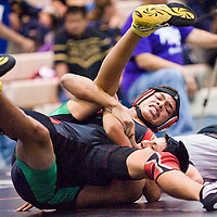 120812       Cable Hoover<br /> <br /> Grants Pirate Ryan Fitzpatrick, top, puts a finishing move on Newcomb Skyhawk Alex Allen during the Gallup Duals wrestling meet at Chief Manuelito Middle School in Gallup Saturday.