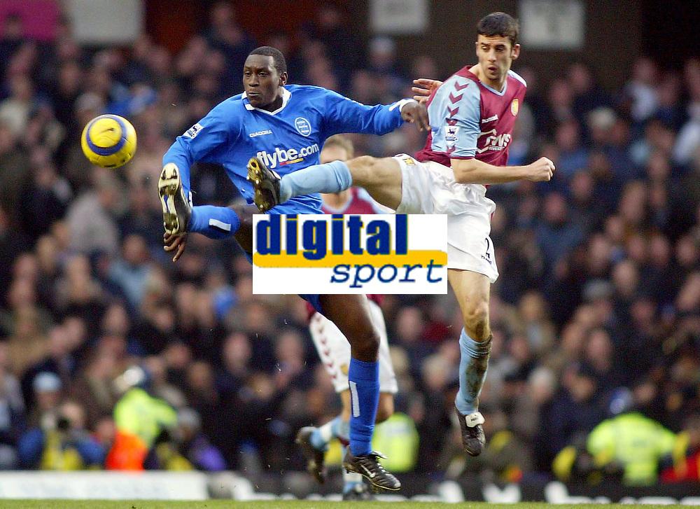 Fotball<br /> Premier League 2004/05<br /> Aston Villa v Birmingham<br /> Villa Park<br /> 12. desember 2004<br /> Foto: Digitalsport<br /> NORWAY ONLY<br /> Aston Villa's Mark Delaney and Birmingham City's Emile Heskey leap for the ball