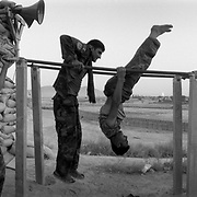 Afghan Army (ANA) soldiers exercising after prayer in their area at a Canadian Forward Operating Base (FOB) located in the Sperwan area of Panjway (Panjwai) District located west of Kandahar City, Kandahar Province, Afghanistan.