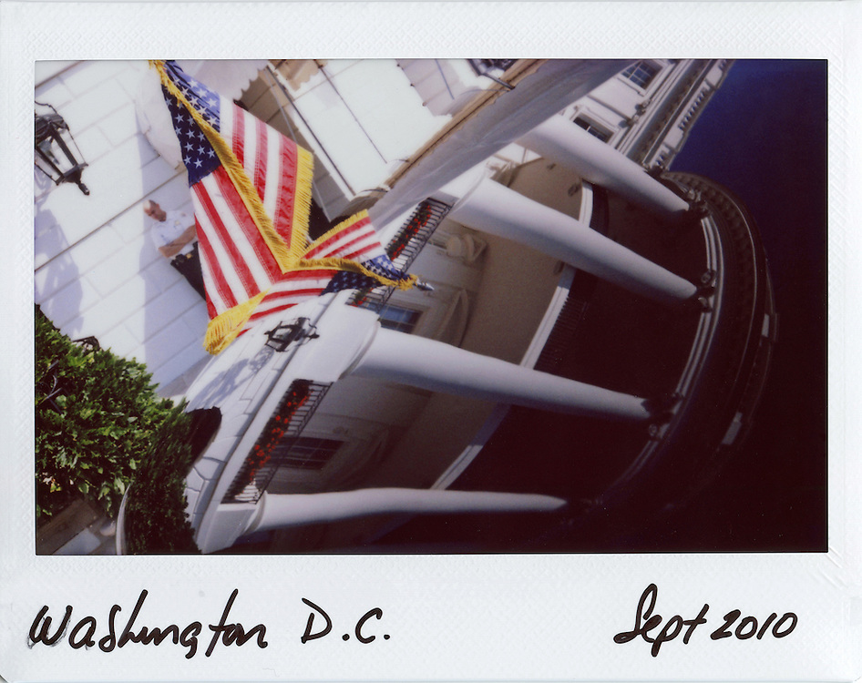 The White House is reflected in the hood of U.S. President Barack Obama's limousine in Washington, September 22, 2010.