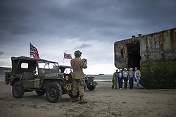 History enthusiasts in uniform photograph each other in front of the ruins of a pontoon on the Normandy coast ahead of the 75th D-Day anniversary, in Arromanches, France, 04 June 2019. World leaders are to attend memorial events in Normandy, France on 06 June 2019 to mark the 75th anniversary of the D-Day landings, which marked the beginning of the end of World War II in Europe.Photo by Eliot Blondet/ABACAPRESS.COM