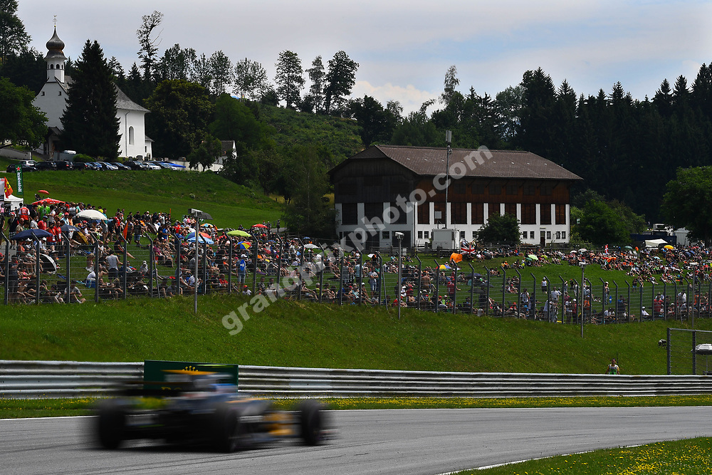 Renault with fans and church at local scenery during practice for the 2017 Austrian Grand Prix at the Red Bull Ring in Spielberg. Photo: Grand Prix Photo