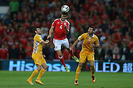 Ben Davies of Wales © jumps to head the ball .Wales v Moldova , FIFA World Cup qualifier at the Cardiff city Stadium in Cardiff on Monday 5th Sept 2016. pic by Andrew Orchard, Andrew Orchard sports photography