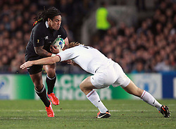 © Andrew Fosker / Seconds Left Images 2011 - New Zealand's Ma'a Nonu tries to get past France's Aurelien Rougerie - France v New Zealand - Rugby World Cup 2011 - Final - Eden Park - Auckland - New Zealand - 23/10/2011 -  All rights reserved..