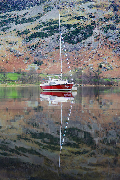 © Licensed to London News Pictures. 02/01/2019. Glenridding UK. A boat reflects into the calm water of Ullswater lake near Glenridding in Cumbria this morning. Photo credit: Andrew McCaren/LNP