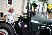 Gracelyn Hodgman, 5, of Dodge Center pretends she's driving at the tractor pull during Sauerkraut Days in Henderson, MN, June 23, 2012.  Her dad was the one who actually competed in the event.