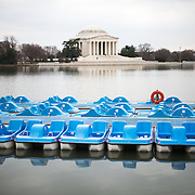 Paddle boats in front of the Jefferson Memorial.