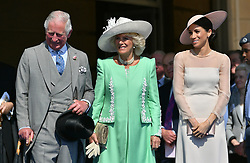 File photo dated 22/05/18 of the Prince of Wales and the Duchess of Cornwall with the Duchess of Sussex (right). Baby Sussex will be the Prince of Wales's fourth grandchild.