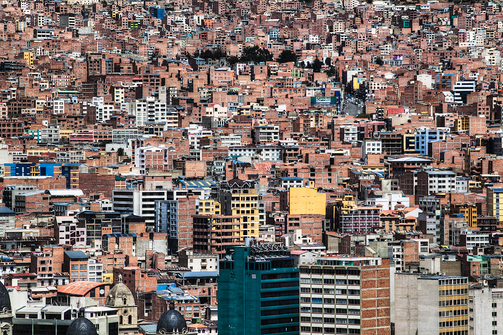 Similar shapes of buildings, mainly made of brick, in the capital city of La Paz, Bolivia in South America.