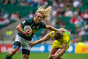 """Twickenham, United Kingdom, South African, Werner KOK, """"hands off """", Australian defenders in the Cup Quarter Final RSA vs AUS., 26th May 2019, HSBC London Sevens,  played at  the  RFU Stadium, Twickenham, England, <br /> © Peter SPURRIER: Intersport Images<br /> <br /> 11:14:37 26.05.19"""