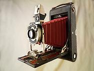 Kodak Brownie folding camera with red bellows & Kolios shutter