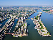 Nederland, Noord-Holland, Gemeente Amsterdam; 02-09-2020; Overzicht voormalig Oostelijk havengebied. Knsm-eiland met Verbindingsdam. Daarachter Java-eiland. Midden Sporenburg (met Keesje Brijdeplantsoen), geheel links Borneo-eiland. Zicht op de Binnenstad en Grachtengordel.<br /> Overview former Eastern port area, old port of Amsterdam. Knsm Island with Connecting Dam. Behind it Java island. Middle Sporenburg (with Keesje Brijderplantsoen), far left Borneo island. View of the Inner City and Belt of canals.<br /> luchtfoto (toeslag op standaard tarieven);<br /> aerial photo (additional fee required)<br /> copyright © 2020 foto/photo Siebe Swart