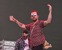 April 28, 2018 - Indio, CA, U.S. - INDIO, CA - APRIL 28:  T.J. Osborne of the Brothers Osborne makes his way onto the stage at Stagecoach, California's Country Music Festival on April 28, 2018 at the Empire Polo Club in Indio, CA. (Photo by Tom Walko/Icon Sportswire) (Credit Image: © Tom Walko/Icon SMI via ZUMA Press)