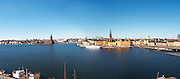 A wide panorama over Riddarfjarden water from left to right: the Soder key, Kungsholmen, The Stadshuset Town Hall, Riddarholmen with the white cruise ship hotel and restaurant Malardrottningen (previously owned by the American billionaire Barbara Hutton), the Gamla Stan Old Town and the Centralbron bridge Stockholm, Sweden, Sverige, Europe