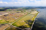 Nederland, Zeeland, Oosterschelde, 09-05-2013; inlagen ten zuiden van Serooskerke. Landinwaarts zijn polders onder water gezet in het kader van Plan Tuureluur. Rechts(onder) de Oosterschelde. Nationaal Park De Oosterschelde<br /> Land between the inner (original) dike and the sea dike near Serooskerke. Inland polders are inundated under the nature development project Tureluur. Oosterschelde right.<br /> luchtfoto (toeslag op standard tarieven);<br /> aerial photo (additional fee required);<br /> copyright foto/photo Siebe Swart.