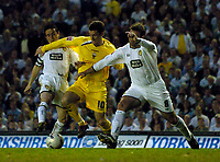 Photo: Jed Wee.<br /> Leeds United v Preston North End. Coca Cola Championship. Play-off, First Leg. 05/05/2006. <br /> <br /> Preston's David Nugent (C) runs between two Leeds players in the build up to his goal.