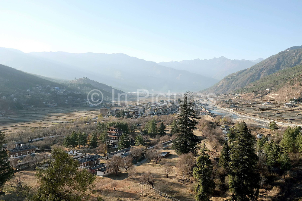 A view of the small town of Paro on the banks of the Pa Chhu river from Rinchen Pung (Rinpung) Dzong in Western Bhutan. Paro town lies in the centre of the valley at an average elevation of 2880 m and was first formed in 1985 with one main street, lined with colourfully painted shops and restaurants. Recently new constructions in Bhutanese style have taken place at the back of the main street.