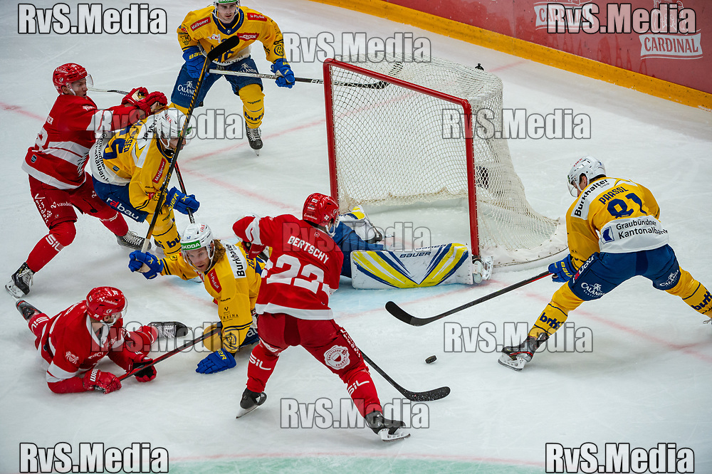 LAUSANNE, SWITZERLAND - SEPTEMBER 24: Christoph Bertschy #22 of Lausanne HC scores a goal against Goalie Gilles Senn #91 of HC Davos during the Swiss National League game between Lausanne HC and HC Davos at Vaudoise Arena on September 24, 2021 in Lausanne, Switzerland. (Photo by Robert Hradil/RvS.Media)