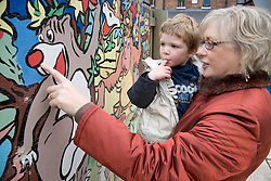Grandmother and young boy looking at mural,
