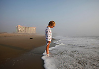 www.shawnrocco.com<br /> www.cellularobscura.com<br /> 919-812-8291<br /> shawnrocco@gmail.com<br /> <br /> <br /> <br /> Jack Camper, 4, watches as the ocean rises over his feet at Nags Head on Monday, August 29, 2011. Traveling from Roanoke, Virginia, he and his family were staying in the Comfort Inn South, right behind him, as they waited for word from their realtor on whether they could head to their beachhouse rental in Corolla. N.C. 12 in Duck was still closed to visitor traffic on Monday morning.