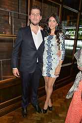 GEORGE BUGAKOV owner of Sackvilles and SANDRA KHOURY at a party to celebrate the launch of Sackville's Bar & Grill, 8a Sackville Street, London on 15th July 2015.