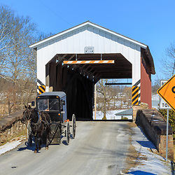 An Amish buggy exits the Weaver Mill Covered Bridge in Lancaster County, Pennsylvania.