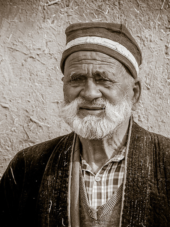 Portrait of an old Tajik man wearing a taqiyah, the traditional Moslem square cap of Central Asia