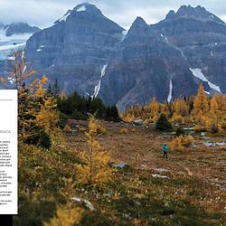 A double-page spread in Trail Runner Magazine of Sherri Castiglione running the Larch Valley Trail near Moraine Lake, Valley of the Ten Peaks, Alberta, Canada