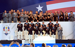 Team USA, with partners, wives and girlfriends behind during the opening ceremony of the Ryder Cup at Le Golf National, Saint-Quentin-en-Yvelines, Paris.
