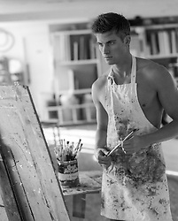 Young artist working on a new painting in an artist studio