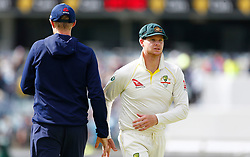 Australia's Steve Smith shakes hands with Joe Root during day five of the Ashes Test match at the WACA Ground, Perth.