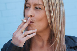 Portrait of white woman smoking. Cleared for Mental Health issues.