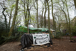 A banner at a protection camp in ancient woodland at Jones Hill Wood occupied by activists opposed to the HS2 high-speed rail link is pictured on 28th April 2021 in Wendover, United Kingdom. Felling of Jones Hill Wood, which contains resting places and/or breeding sites for pipistrelle, barbastelle, noctule, brown long-eared and natterer's bats and is said to have inspired Roald Dahl's Fantastic Mr Fox, has recommenced after a High Court judge yesterday refused environmental campaigner Mark Keir permission to apply for judicial review and lifted an injunction on felling for the rail infrastructure project.
