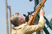 Belgian Crown Prince Filip and Dutch Queen Beatrix attend the 100 years' jubilee of the Old Limburgs Citizens Soldiers in Stramproy, in southern Netherlands near the Belgian border.<br /> <br /> Hare Majesteit de Koningin en Zijne Koninklijke Hoogheid Prins Filip van België bezoeken het 100-jarig jubileum van  het Oud Limburgs Schuttersfeest in Stramproy. Honderd jaar geleden vond voor het eerst een schuttersevenement plaats onder de naam Oud Limburgs Schuttersfeest. Het is een jaarlijks evenement waaraan ruim 160 schutterijen uit zowel Nederlands als Belgisch Limburg deelnemen. <br /> <br /> On the photo / Op de foto: <br /> <br />  Belgian crownprince Filip tries an old gun / Flip doen een poging bij het koninschieten