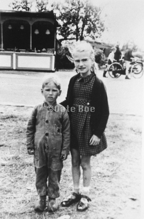 two children posing for photographer 1960s