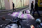 Pedestrians in a Soho side-street, pattened with purple.