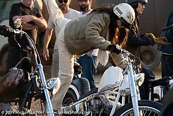 Kickstarting her Harley-Davidson Shovelhead chopper after the Okie Dokie Vintage Races put on by Go Takamine's Brat Style at West Point Off-Road Village, Kawagoe, Saitama, Japan. Tuesday, December 4, 2018. Photography ©2018 Michael Lichter.