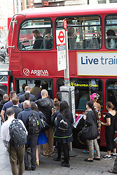 © Licensed to London News Pictures. 08/07/2015. London, UK. City workers queuing to get on a bus outside Liverpool Street station in London. London transport workers begin strike action tonight, which will continue tomorrow. Photo credit : Vickie Flores/LNP