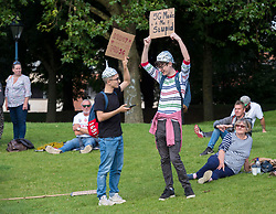 "© Licensed to London News Pictures;30/08/2020; Bristol, UK. A ""Stand Up Bristol"" protest rally by Stand Up X takes place in Castle Park. The event organisers say it is for truth and freedom. Many are against UK restrictions for coronavirus covid-19 and against lockdown. Some participants are against wearing masks and social distancing, and some either believe conspiracy theories that covid-19 is a hoax or that the virus is man made. Photo credit: Simon Chapman/LNP."