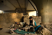 Three homeless youths sleep together under a railway arch in Delhi, India<br /> It is estimated that around than 150000 people - more than one percent of the city - is homeless and, with constant migration this is increasing on a daily basis.