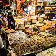 Assorted nuts, dried fruits, and other items on display out the front of a store next to the Spice Bazaar (also known as the Egyption Bazaar) in Istanbul, Turkey.