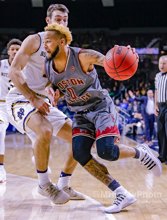 SOUTH BEND, IN - JANUARY 12: Ky Bowman #0 of the Boston College Eagles drives to the basket against Nate Laszewski #14 of the Notre Dame Fighting Irish at Purcell Pavilion on January 12, 2019 in South Bend, Indiana. (Photo by Michael Hickey/Getty Images) *** Local Caption *** Ky Bowman; Nate Laszewski